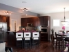 Kitchen and dining area within Kirkland Master Builders Single Family showhome at Starling at Big Lake