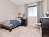 Second bedroom in Rohit Communities Duplex showhome at Starling at Big Lake